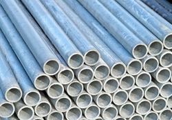 pile of iron pipes for the transport of electrical cables and optical fibres and municipal tap water