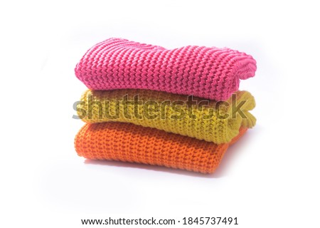 Pile of knitted woolen sweaters autumn colors. Clothes  Stock photo ©