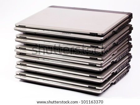 Pile of laptops on the white background