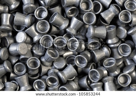 Pile of lead air-gun pellets close-up background texture