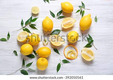 Shutterstock Pile of lemons on wooden table