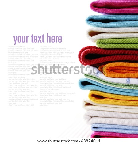 Pile of linen kitchen towels on a white background (with sample text)