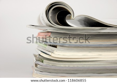 Pile of magazines over white background