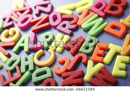 """Pile of magnetic letters with the hidden word """"Alphabet"""""""