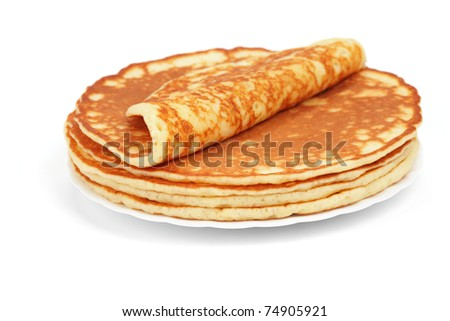 Pile of magnificent barmy pancakes on a white background