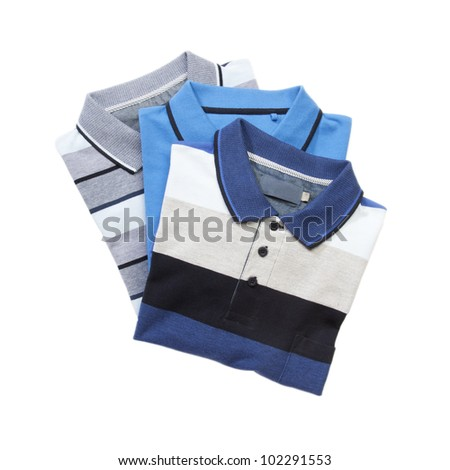 Pile of man polo shirts on white