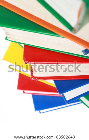 pile of many colorful books isolated on white background