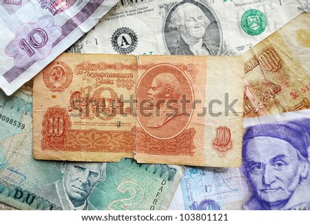 Pile of Many different banknotes. Lithuanian - litas, Russian - rouble, USA - dollar.