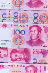 pile of many type china banknotes,  yuan currency. the currency which Influence on the world economy. money game powers. economy and funds concept.