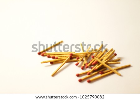 Pile of matches on white background #1025790082