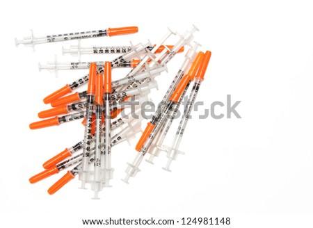 Pile of Medical syringes on white background