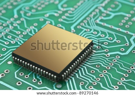 pile of microchips on a printed circuit board