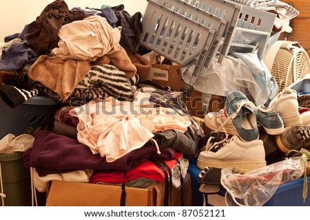 Pile of misc items stored in an unorganized fashion in a room Stock foto ©