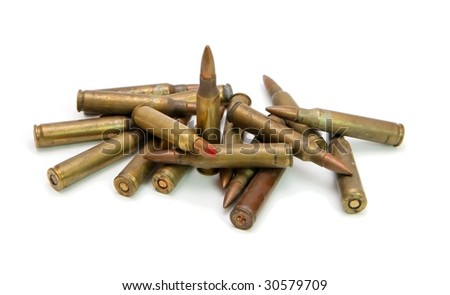 Pile of 5.56mm M16 assault rifle cartridges isolated