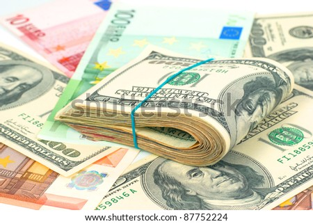 Pile of money- cash of US dollars and euros for business background