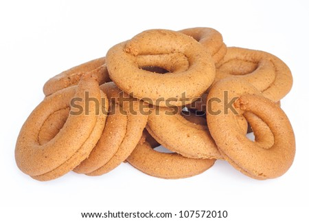 Pile of moustokouloura, Greek grape juice biscuits, on a white background.