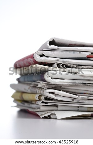pile of newspaper with white background - stock photo
