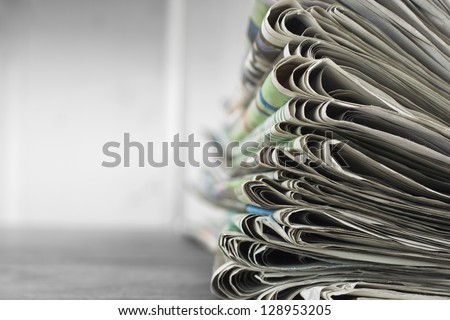 Pile of newspapers with space