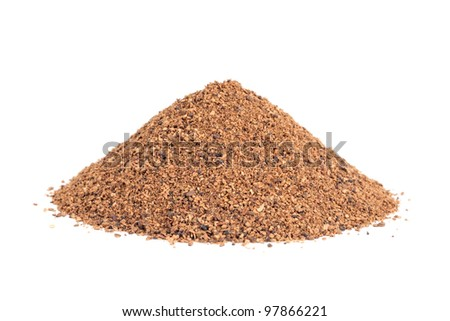 Pile of Nutmeg powder (Myristica fragrans) isolated on white background. Used as a spice in many sweet as well as savoury dishes and medicine.