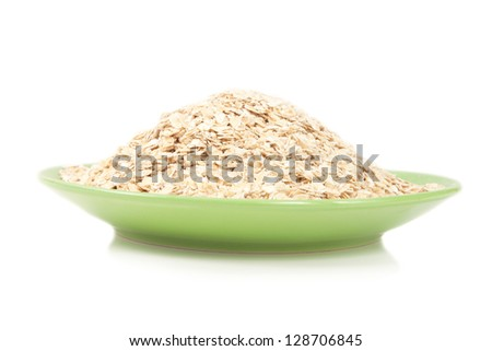 pile of oatmeal on a green plate isolated on white background