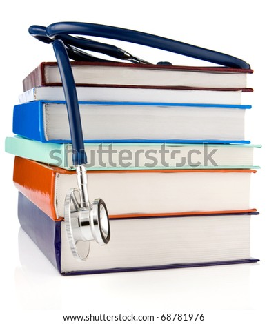 pile of old books and stethoscope isolated on white background