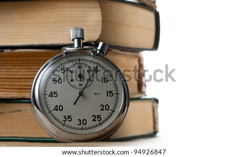 Pile of old books and stopwatch