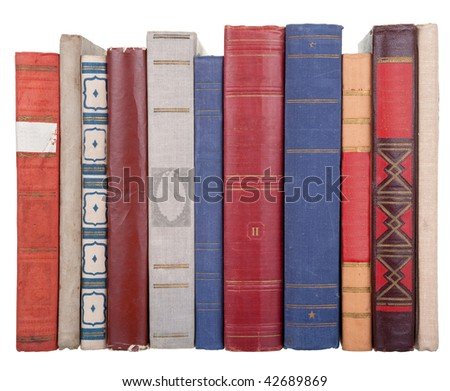pile of old books on a white background
