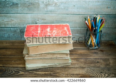 Pile of old books on a wooden table  #422669860