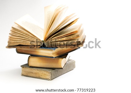 Pile of old books on the white background - stock photo