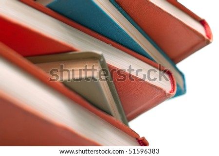 Pile of old books on white background. Isolated, shallow DOF