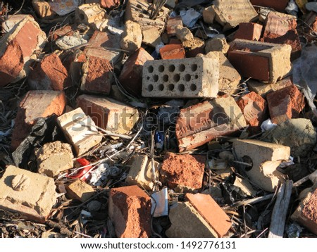 Pile of old bricks and rubble #1492776131