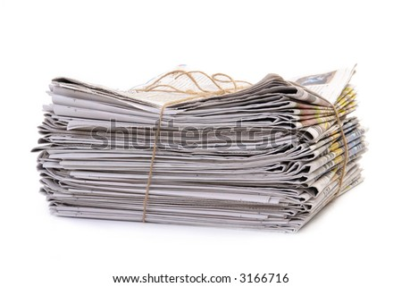 Pile of old newspapers tied with string over white