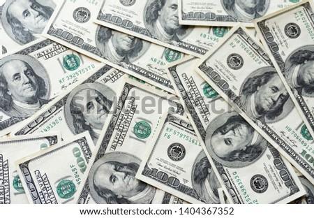 Pile of old one hundred dollar bills bills, close up dollars.