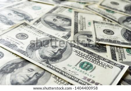 Pile of old one hundred dollar bills bills, close up dollars