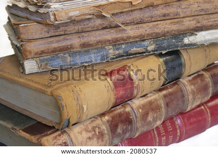 Pile of old public record books from early 1900, on white - stock photo