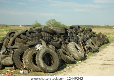 Pile of old tires near the road