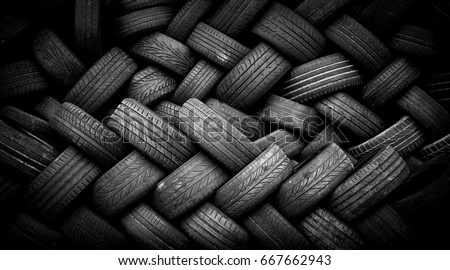 Pile of old tires neatly arranged. #667662943