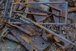 pile of old trash steel bar and plate covered with rusty on the ground
