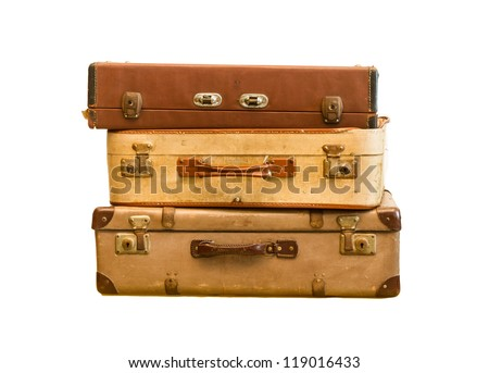 Pile of old vintage bag suitcases on isolate background