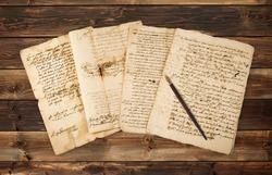 Pile of old vintage manuscripts with nib
