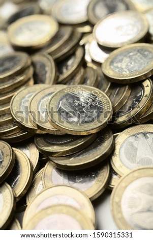 Pile of One Euro coins