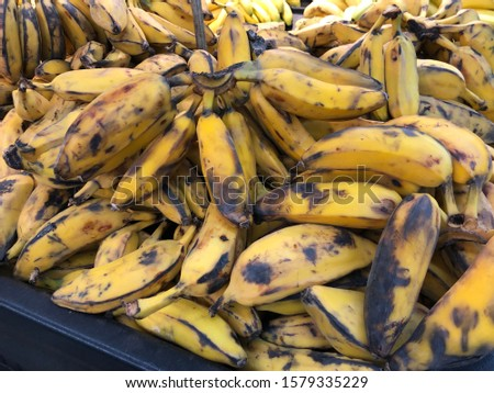 Pile of over-riped yellow bananas at a fresh market