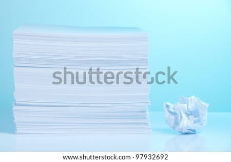 Pile of paper and small crumpled paper sheet