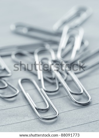 Pile of paper clips on workbook,closeup, for office,attachment themes