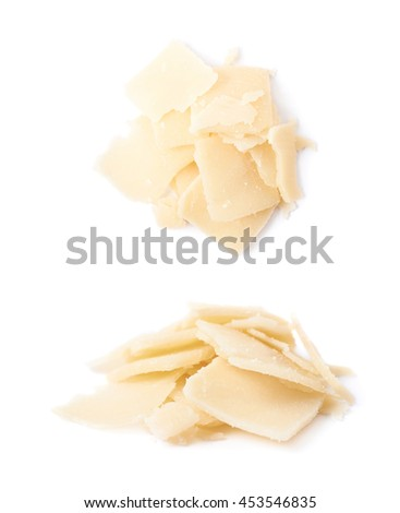 Pile of parmesan cheese flakes isolated over the white background, set of two different foreshortenings