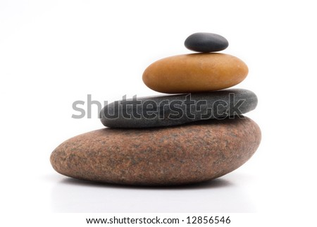 Pile of pebbles close-up on a white background