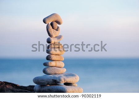 Pile of pebbles each other on a sea boulder
