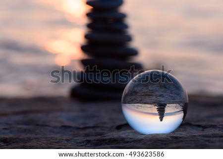 Pile of pebbles reflected inside the crystal ball  #493623586