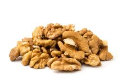 Pile of peeled walnuts, closeup.