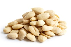 Pile of peeled whole almonds isolated on white.